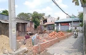 Nhà hàng xóm xây dựng lấn chiếm sang phần đất của nhà mình.